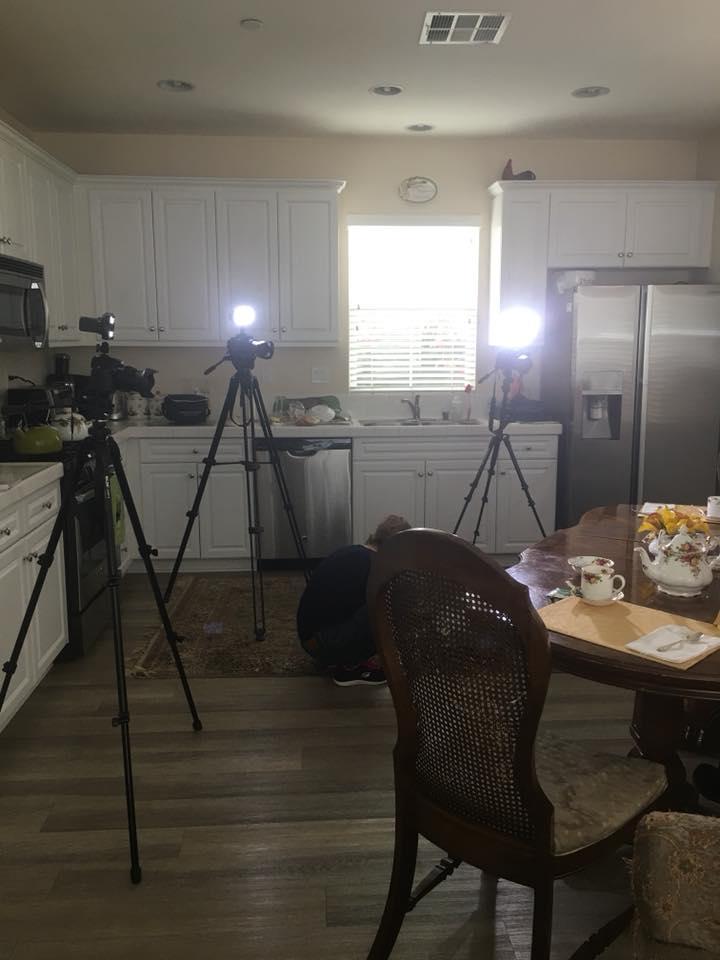 3 cameras set up in a kitchen