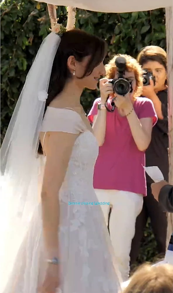 Bonnie Taking A Photo Of The Bride In A Wedding